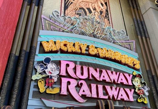 Neon sign for Mickey & Minnie's Runaway Railway.